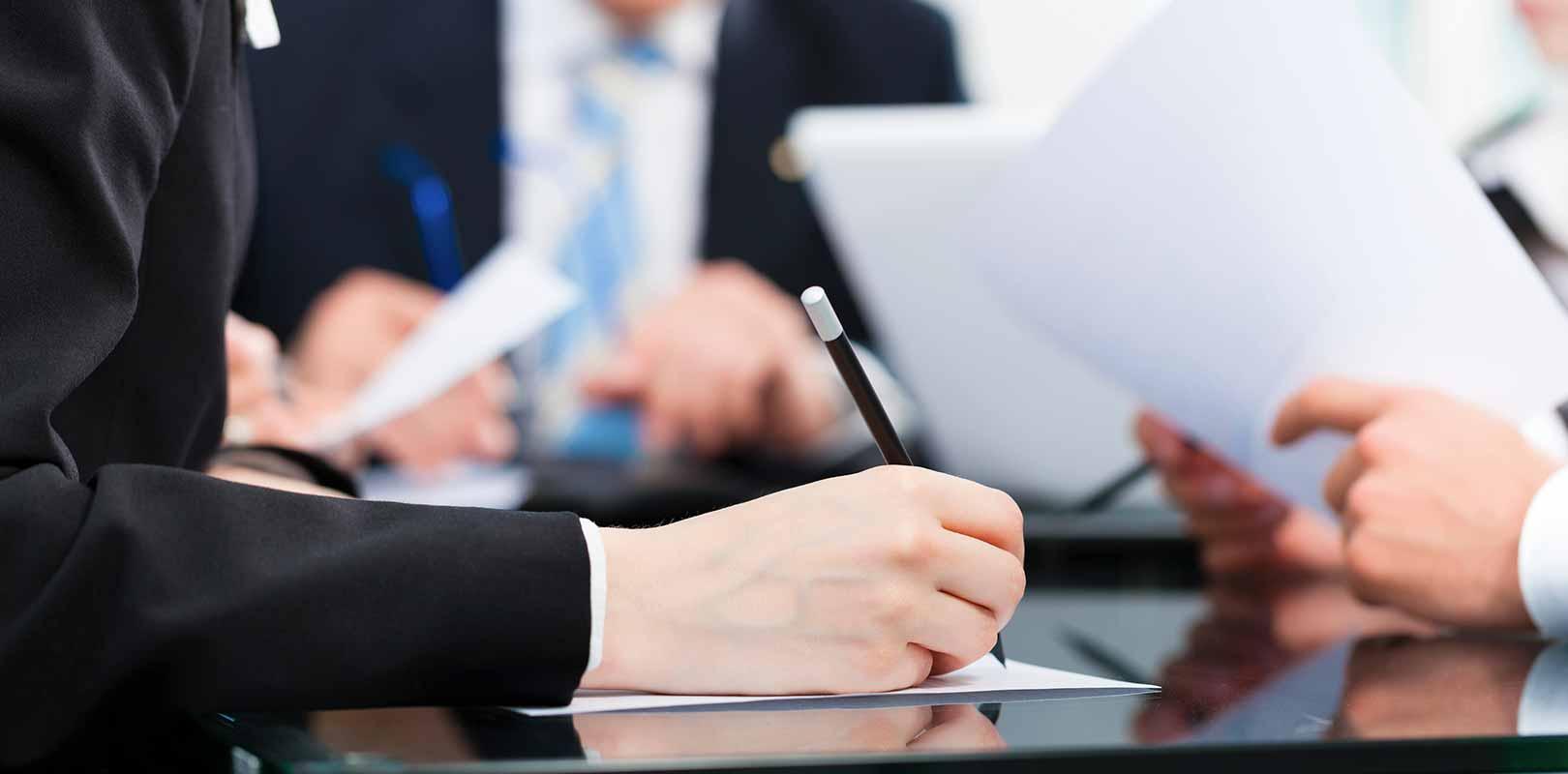An insurance expert documenting a claim