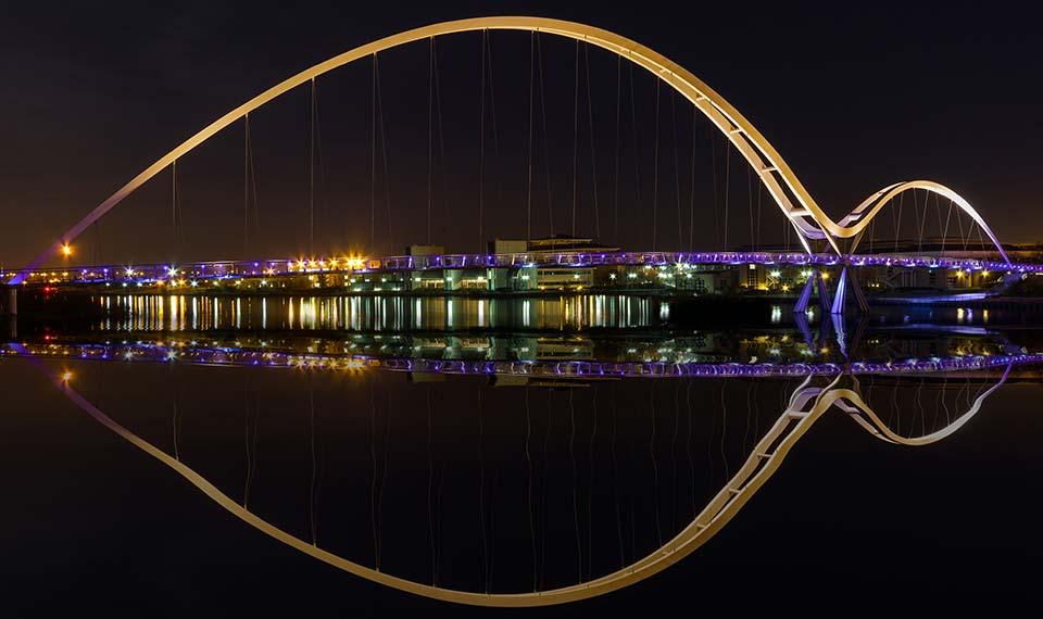 Stockton Infinity Bridge at night